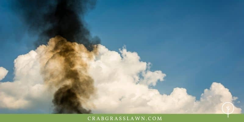 black smoke from a lawn mower